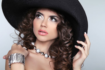 Beautiful Fashion Woman with Curly Long Hair. Elegant lady in ha