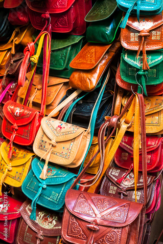 Deurstickers Tunesië Colorful leather handbags collection on Tunis market