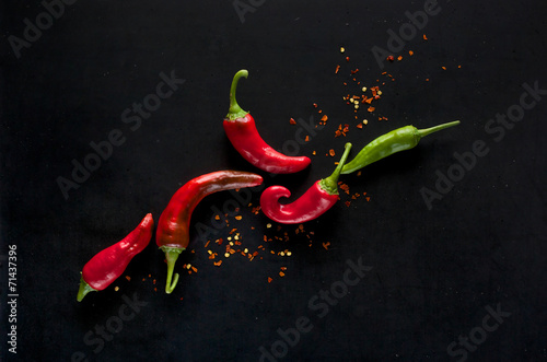Fototapeta Chili peppers on a black background