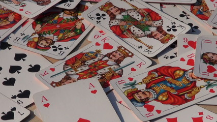 various playing card background rotate on table