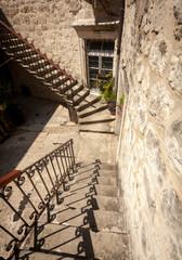 stone double staircase at backyard of ancient house