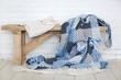 Leinwanddruck Bild - Patchwork quilt on rustic bench