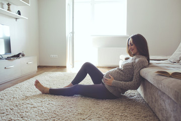 Home portrait of pregnant woman