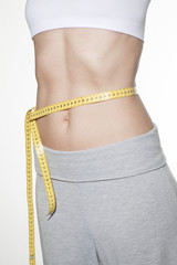 Close Up Woman measuring her hips