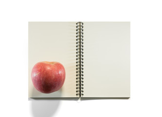 Opened note book with apple