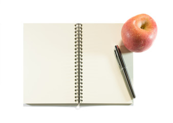 Notebook and apple isolated on a white