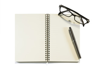 Notebook with glasses isolated on a white