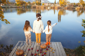Kids playing near the lake in autumn