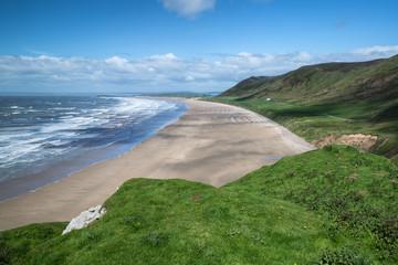 Beautiful Summer landscape of Rhosilli Bay beach Gower peninsula