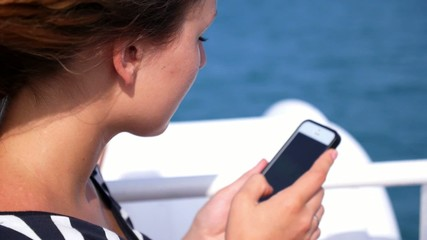 Woman Using Cell Phone. Reading Sms on Mobile Smartphone.