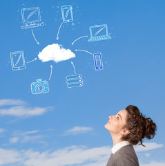 Casual girl looking at cloud computing concept on blue sky