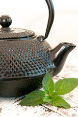 Black iron asian teapot with mint