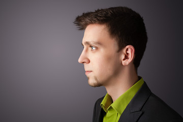 Young businessman thinking with copyspace