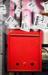 Post box with daily newspapers flying