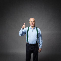 senior man thumbs up with finger