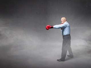 old man boxing in a profile position