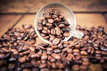 Roasted coffee bean on wood table
