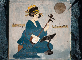 Oriental woman with a musical instrument