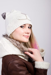 Portrait of beautiful girl in winter clothes