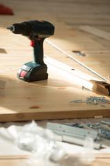 Battery screwdriver on wooden floor