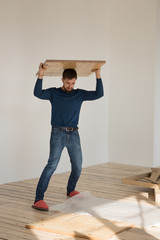 Man Putting Together Self Assembly Furniture