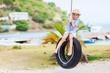 Little girl on tire swing