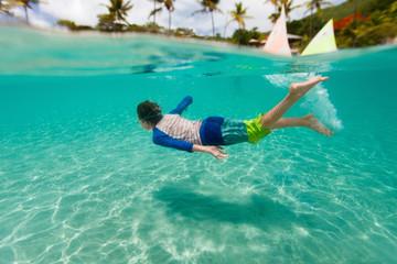 Little boy swimming in ocean
