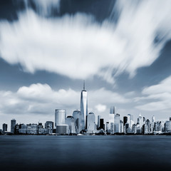 Modern Manhattan cityscape in blue color with blurred sky