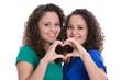 canvas print picture - Hände machen Herz als Symbol für Freundschaft unter Mädchen
