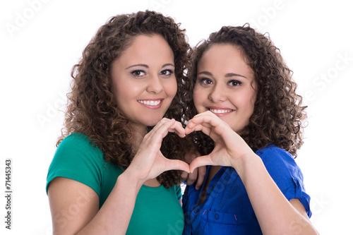 canvas print picture Hände machen Herz als Symbol für Freundschaft unter Mädchen
