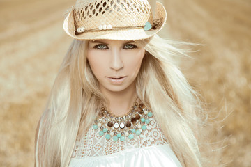 Beautiful, blonde young woman with cowboy hat