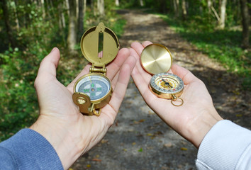 Two compasses in the hands