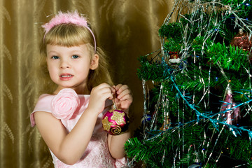 Girl in pink decorated Christmas tree