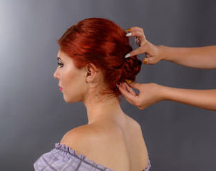 Woman having her hair professionally done by a hair stylist