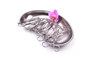 surgical instruments orchid on white