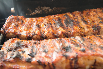 Barbeque ribs cooking on the grill