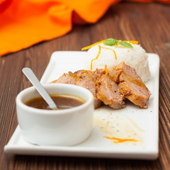 duck breast with orange sauce and rice