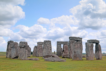 Stonehenge historic site on green grass under blue sky. Stonehen