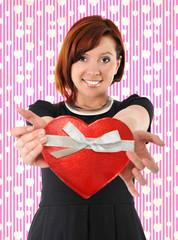 Beautiful woman holding heart shape box anniversary box