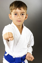 Closeup portrait of little boy training karate