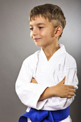 Portrait of an adorable boy in kimono with arms folded