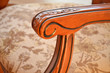 canvas print picture - Detail of armrest an decorative wooden chair
