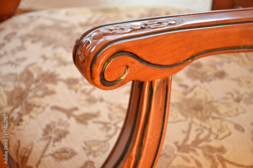 canvas print picture Detail of armrest an decorative wooden chair