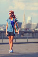 Modern girl walking on the street in Brussels