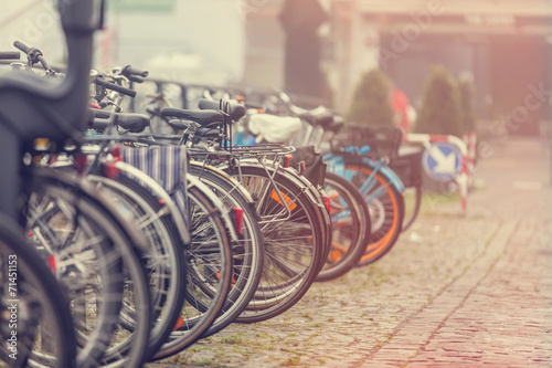 Group of bikes in parking in Amsterdam - 71451153