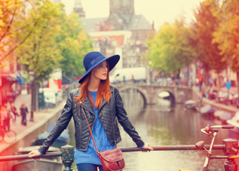 Redhead in hat girl in Amsterdam.