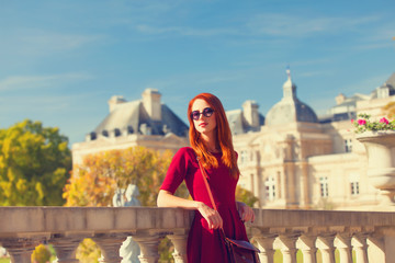 Redhead girl near Luxembourg Palace