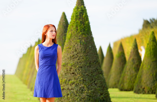 canvas print picture Beautiful redhead girl in Versailles park
