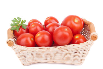 Red tomatoes in a basket.