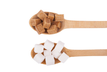 Refined sugar in the spoons on a white background.
